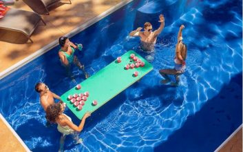 This floating, beer pong table for your pool is a summer must-have