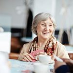 Memory cafes offer dementia patients & caregivers a day out with dignity
