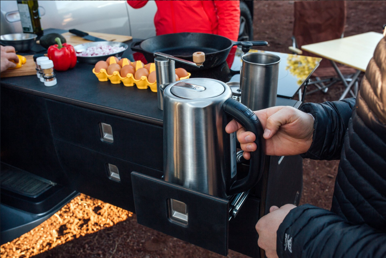 This electric pickup has its own slideout camping kitchen