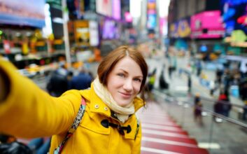Woman taking selfie in Times Square