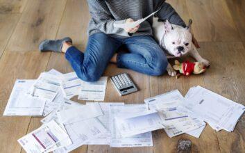 Woman sorting bills and finances