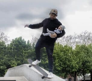 Dad skateboarding with his baby